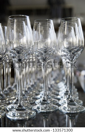 Empty glasses in the hotel bar - stock photo