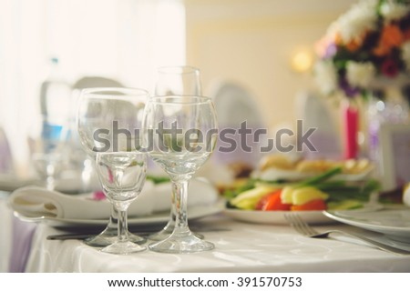 empty glasses on food table with flowers