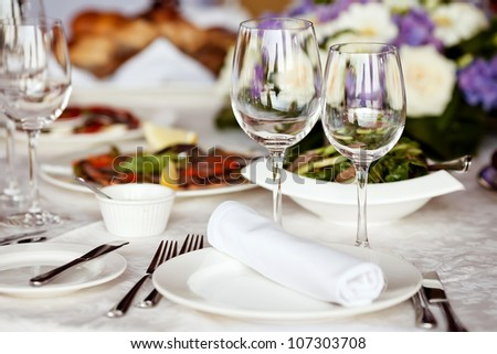 Empty glasses set in restaurant - stock photo