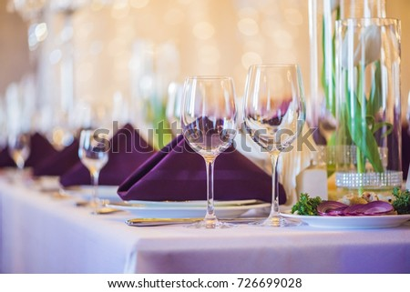 Empty glasses set in restaurant. Catering service concept.
