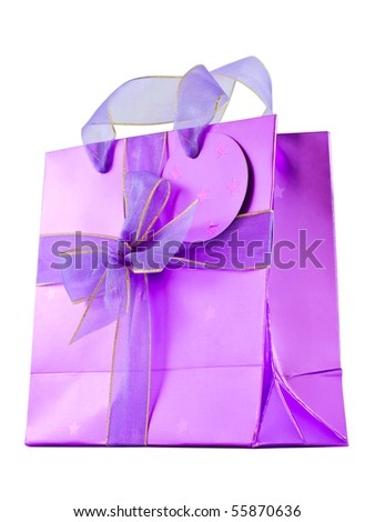 Empty glossy pink gift bag decorated with violet ribbons and a bow, isolated on white - stock photo