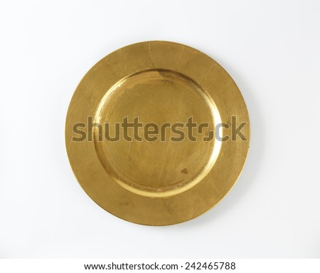 empty gold plate on white background - stock photo
