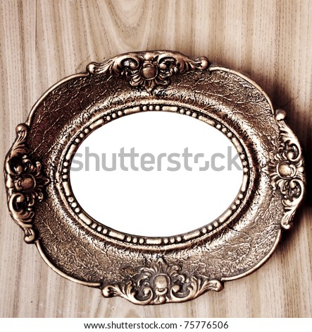 Empty golden vintage frame on wooden wall - stock photo