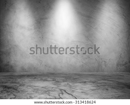 Empty gray wall with 3 spot lights and floor - stock photo