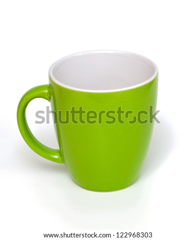 empty green cup over white