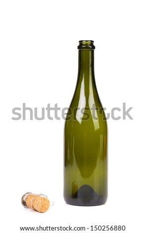 Empty green glass bottle from champagne and cork