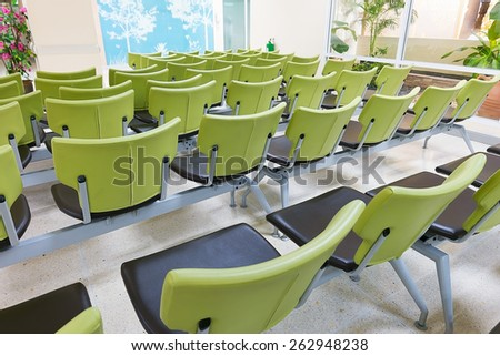 empty green public seat on beautiful & modern waiting area - stock photo
