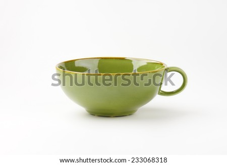 empty green tea cup on white background