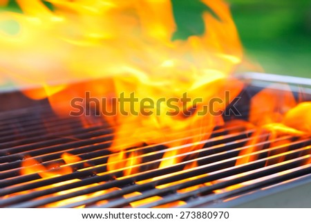 empty grill with flames and space for own things - stock photo