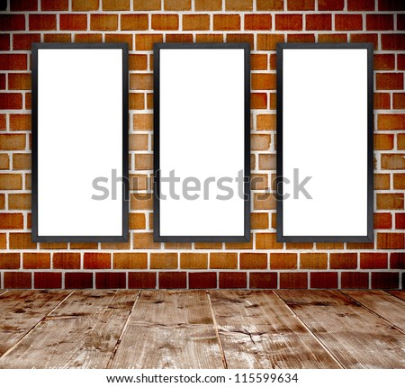 Empty grunge brick wall  interior room with empty wood frames and wooden plank floor - stock photo