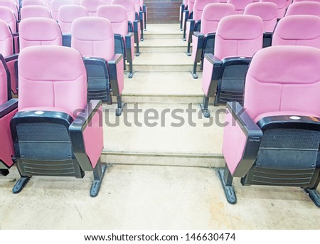 Empty hall for presentation with armchairs - stock photo