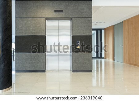 Empty hall of business building having elevator - stock photo