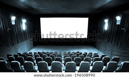 Empty hall of cinema and white screen - stock photo