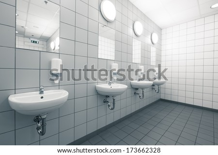 empty hand on a clean public washrooms interior - stock photo