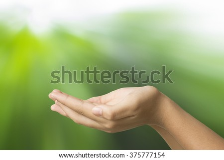 empty hand  woman holding on green abstract background