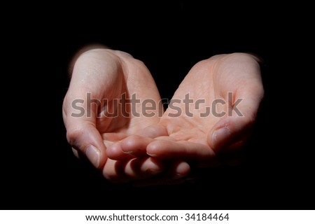 empty hands isolated on a black background