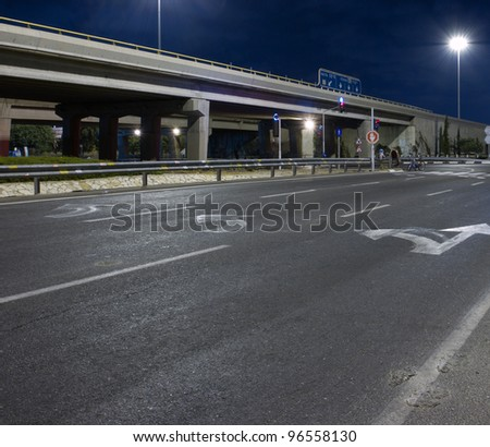 Empty highway at night without people and cars - stock photo