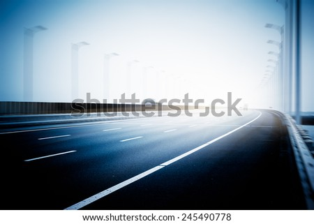 empty highway, blue toned images. - stock photo