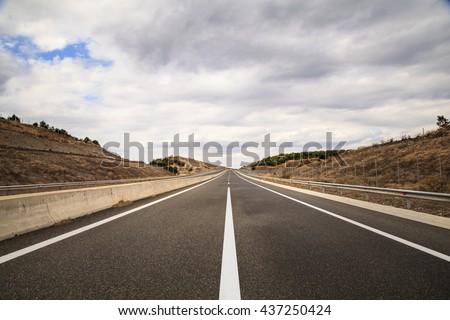 Empty highway.   Highway. Road. Highway. Road. Highway. Road. Highway. Road. Highway. Road. Highway. Road. Highway. Road. Highway. Road. Highway. Road. Highway. Road. Highway. Road. Highway. Road   - stock photo