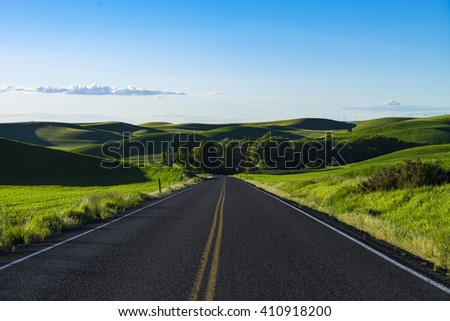 Empty highway in the Palouse region and wheat fields of Eastern Washington state - stock photo