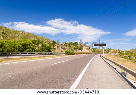 empty highway road in mountain landscape in spain - stock photo