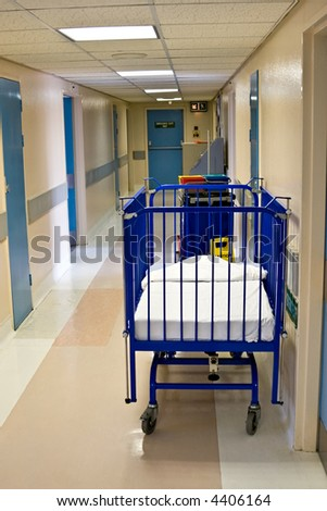 Empty hospital corridor and bed for babies - stock photo