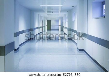 Empty hospital hall with white walls, medicine