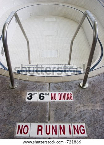 Empty hot tub with warnings