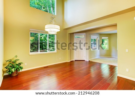 Empty house interior. Foyer with high ceiling and hardwood floor - stock photo