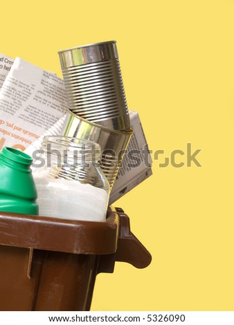empty household containers in a brown recycling bin - stock photo