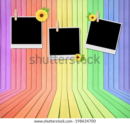 Empty instant photos on colorful wooden room - stock photo