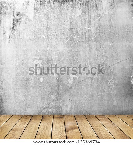 empty interior of vintage room with grey grunge stone wall and old wooden floor.