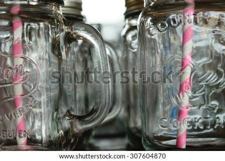 Empty jar with straw - stock photo