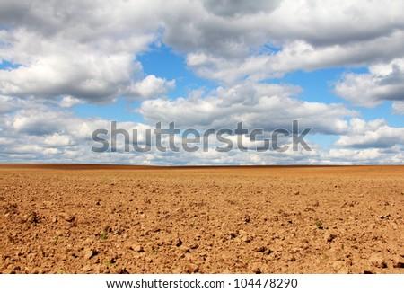 Empty land under blue cloudy sky beautiful landscape - stock photo
