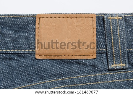 empty leather label on blue jeans