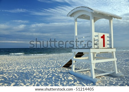 Empty lifeguard hut on deserted beach. - stock photo