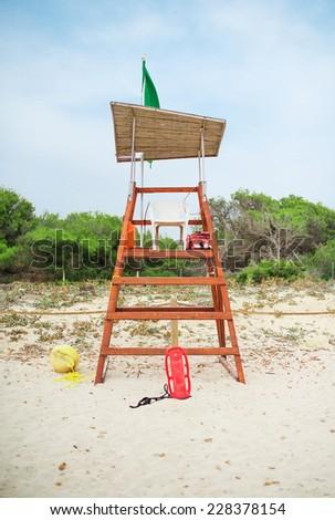 Empty lifeguard tower on the beach. - stock photo