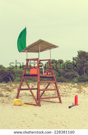 Empty lifeguard tower on the beach. Vintage effect. - stock photo