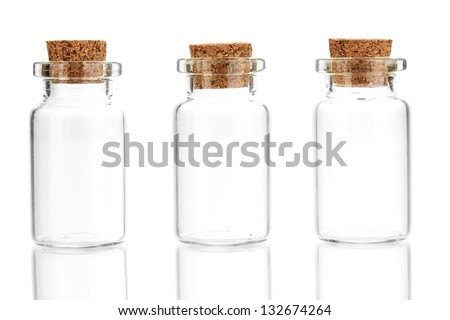 Empty little bottles with cork stopper isolated on white - stock photo