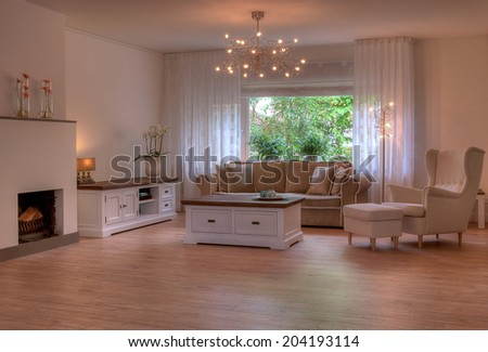 Empty living room in soft colors, with atmospheric lights. - stock photo