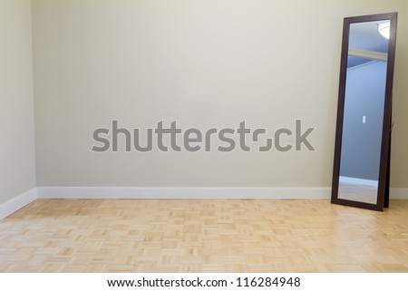 Empty Living Room with mirror in a new apartment - stock photo