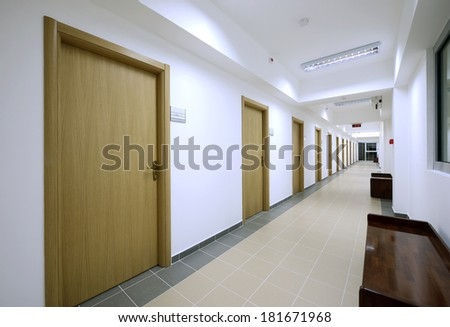 Empty long corridor - stock photo