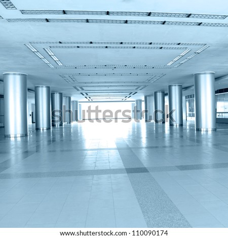 empty long corridor in the modern business building. - stock photo