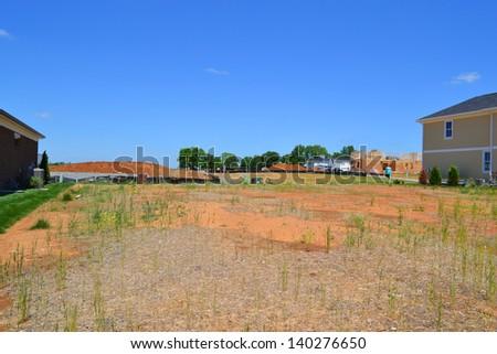 Empty Lot in a Brand New Suburban Neighborhood Development - stock photo