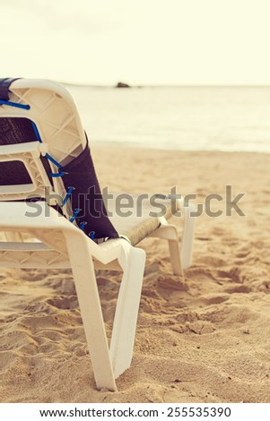 Empty lounger on the beach. - stock photo