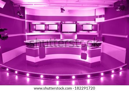 empty magenta television studio ready for work - stock photo