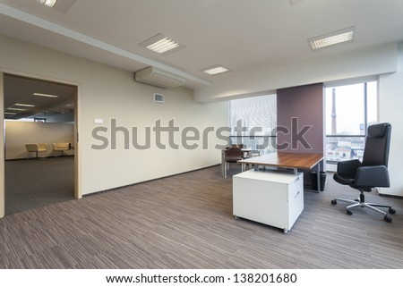 Empty manager's office in a modern building - stock photo