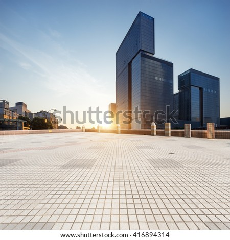 empty marble floor with cityscape and skyline at sunrise - stock photo
