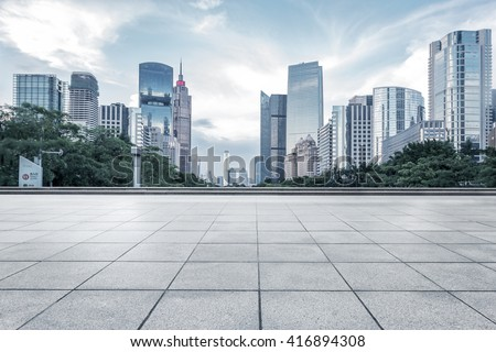 empty marble floor with cityscape and skyline in cloud sky - stock photo