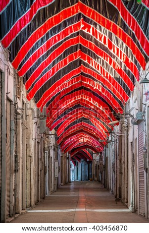 Empty market in Kashan with red and black flags during Ashura in Iran. - stock photo